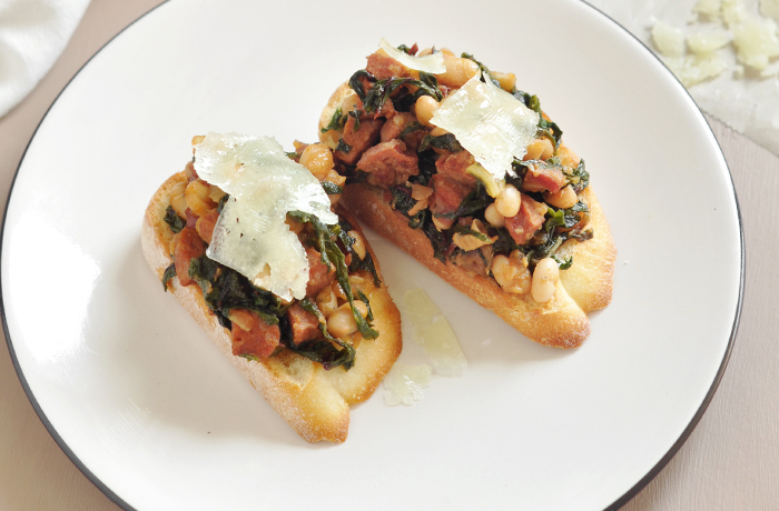 Chorizo, White Bean, and Chard Bruschetta